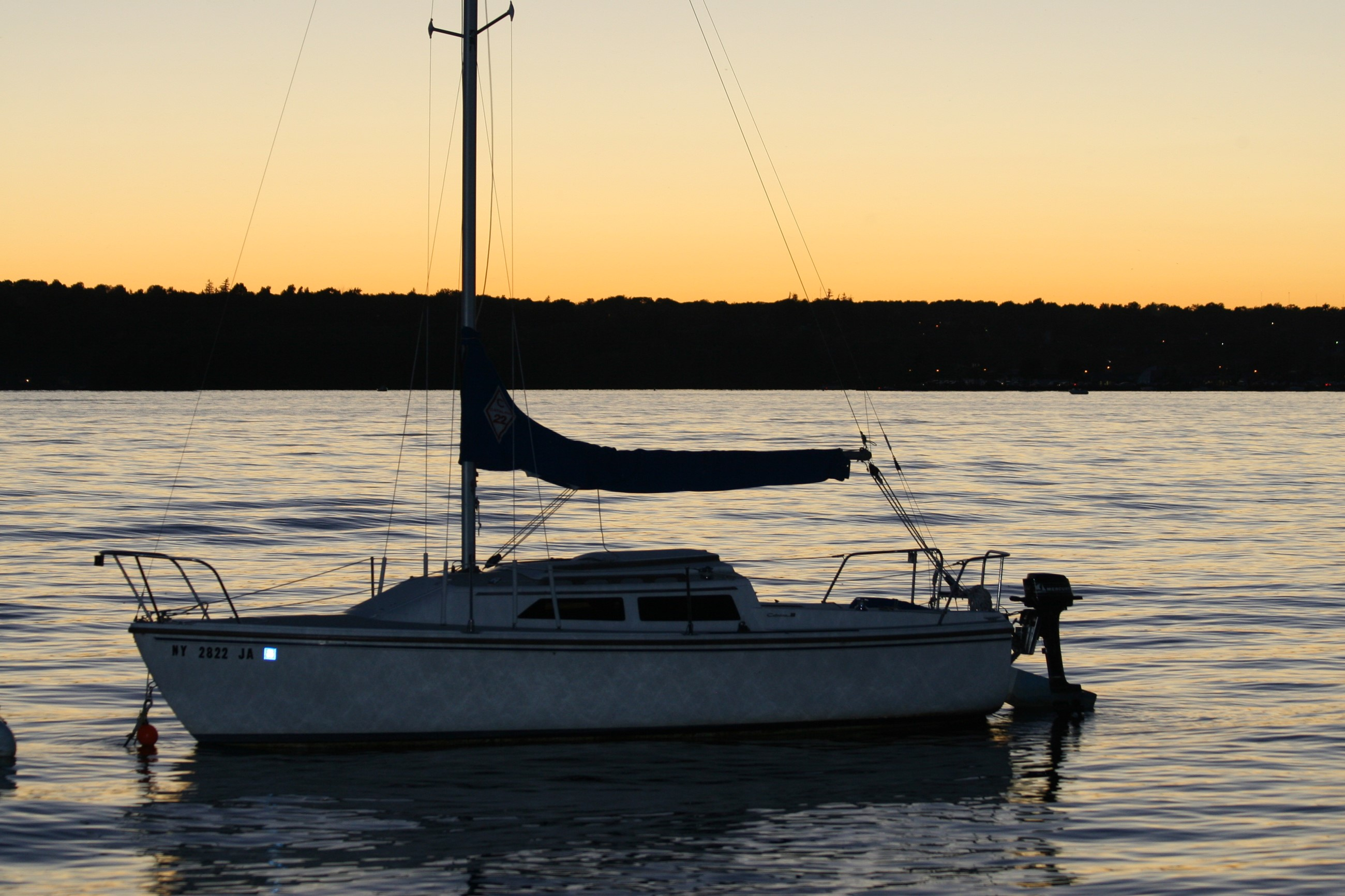 Boat at rest on Canandaigua Lake at sunset